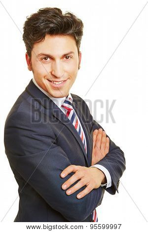 Headshot of smiling business manager with his arms crossed