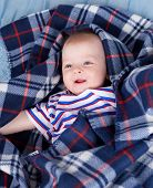 image of little boys only  - Little baby boy hiding beside soft textile - JPG