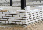 picture of mason  - Mason bricklaying background with clay brick blocks - JPG