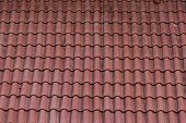 stock photo of tile  - An old red tile roof with cracked tiles - JPG