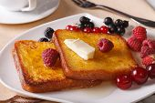 picture of french-toast  - Two French toast with honey and berries on a plate close - JPG