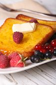stock photo of french-toast  - French toast with raspberries and currants on a plate close - JPG