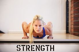 image of step-up  - Woman In Gym Doing Press - JPG