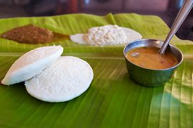 stock photo of indian  - Indian breakfast Idli on palm leaf - JPG