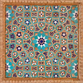 pic of motif  - Flowers and stars motif design in Islamic Iranian pattern made of tiles and bricks - JPG