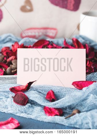 Blank paper note for Valentine's or mother day. Background with dried flower petals