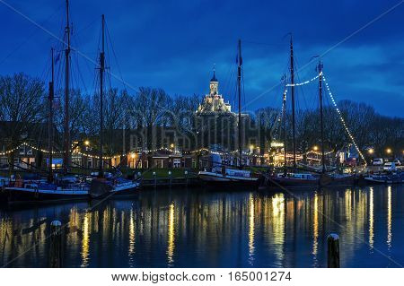 View of Enkhuizen and Buiten harbor from the train station at the evening, Netherlands