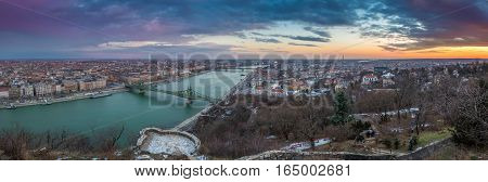 Budapest Hungary - Panoramic skyline view of the city of Budapest with River Danube Szabadsag Bridge and Gellert Bath taken from Gellert Hill at sunset