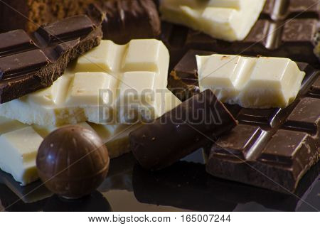 Chocolate In Range On The Black Background