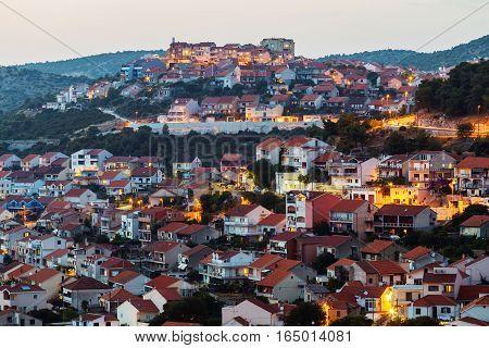 evening Top view of modern buildings in the city of Sibenik, Croatia.