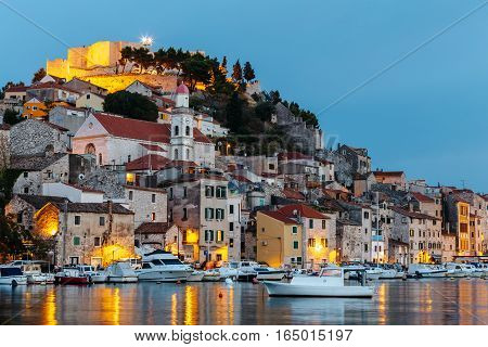 Evening view of the historical part with old houses and St. Michael's fortress in Sibenik, Croatia