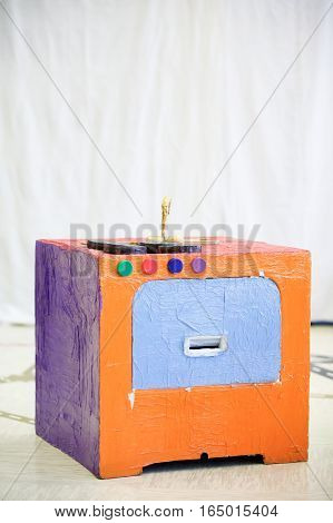 Do-it-yourself kitchen stove made from recycled material. Imaginative and creative playing and creation educational approach concept.