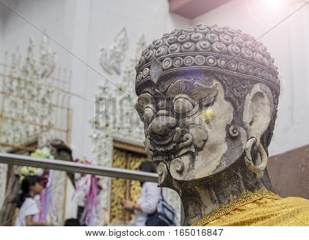 A giant stone statues. White in Temple of Thailand.