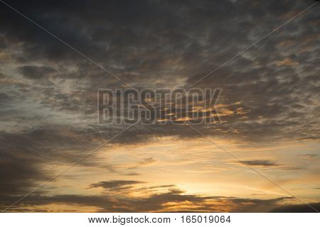 Beautiful evening sky background with golden and silver clouds