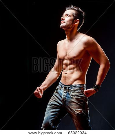 Strong athletic muscular man. The emotional male portrait. Fitness model.