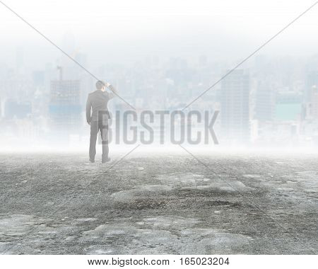 Man Standing And Gazing City Buildings In Mist