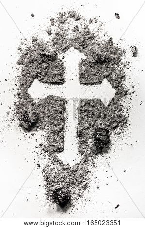 Christian holy cross symbol made in ash dust as a religion concept