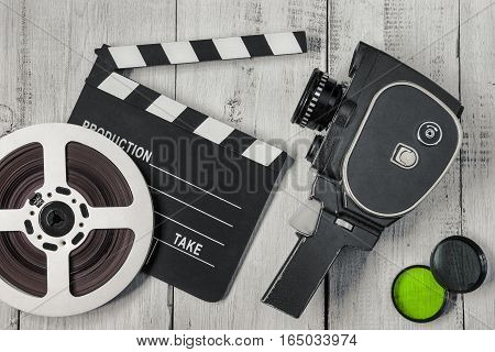 Old movie camera with film reels and filters are painted on the board