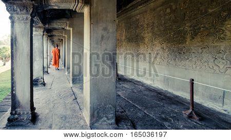 Siem Reap, Cambodia, December 06, 2015: Monk walking at Angkor Wat