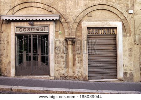 TARQUINIA ITALY - JANUARY 5 2017: ancient architecture between shops in corso Vittorio Emanuele