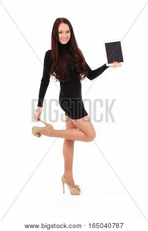 Girl keeps white tablet pc standing sideways isolated on white