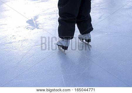 White figure skating. Children skating on ice