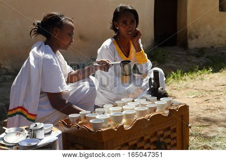 Women do the traditional coffee ceremony in Ethiopia