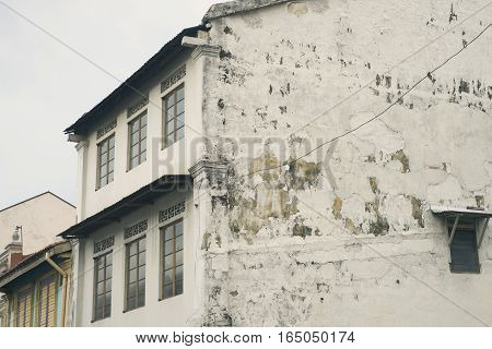 Flaked Building Wall
