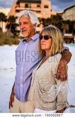 Siesta Key, FL, USA - January 12: Active retirees enjoying a romantic sunset time together on Siesta Key beach in Florida