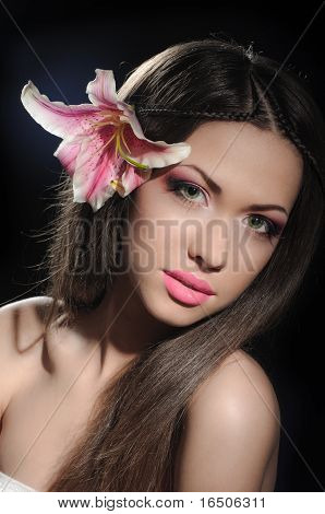 Beauty With Orchid In A Dark