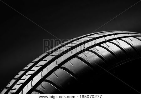 Studio shot of a set of summer, fuel efficient car tires on black background. Contrasty lighting and shallow depth of field