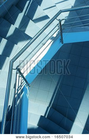 Modern staircase between floors with a metal handrail
