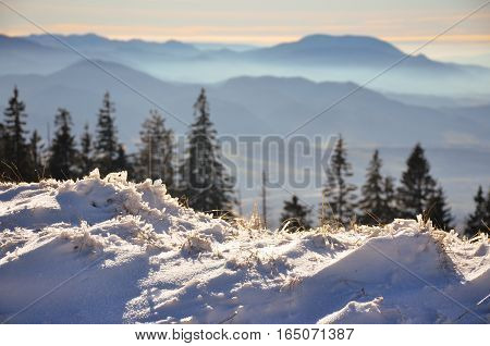 Fantastic evening winter landscape. Dramatic overcast sky in the mountains.
