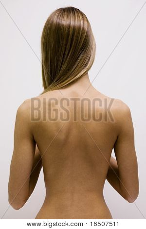 The girl with the naked back and long hair