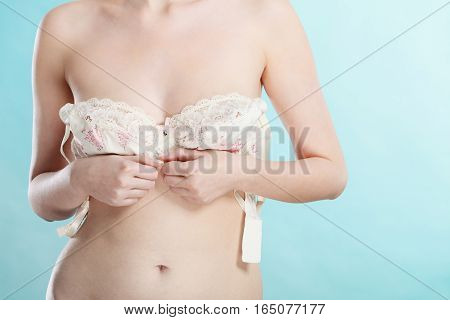 Naked Woman Dressing Up Her Bra.