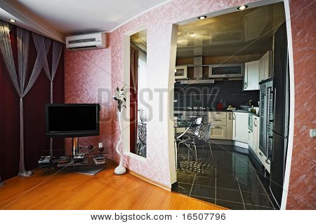 The TV and the air conditioner in a modern apartment