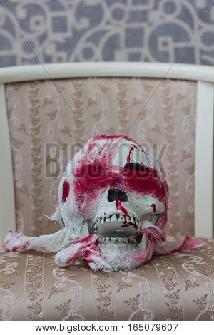 Bloody Human Skull Lying On The Chair
