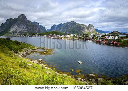 A beautiful fjord houses sheltered by mountains and lakes on Lofoten Islands. January 2017