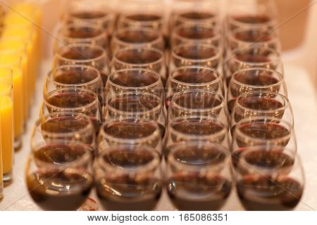 Many glasses of red wine ready for a banquet.