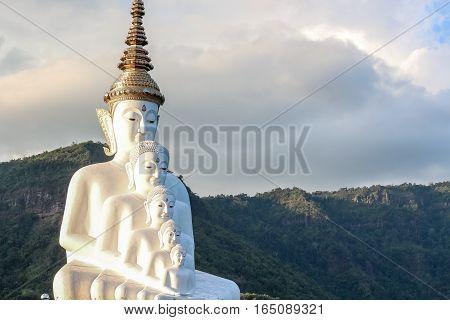 White buddha statueWat Phra That Pha Son Kaew Temple at Khao Khor