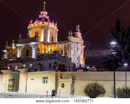 Ancient monument - facade of medieval church in Lviv Ukraine - night scene