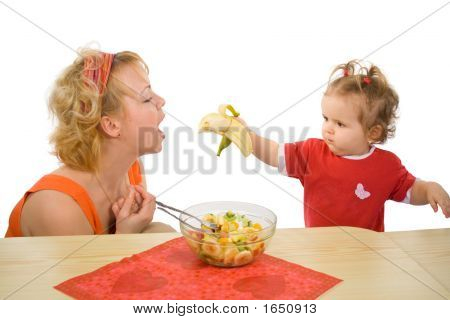 Baby Girl Feeding Mom