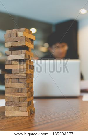 Wood Block With Background Of Businessman Working In Office