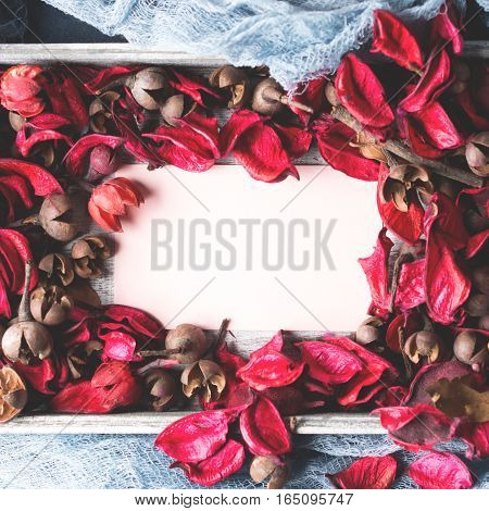 Blank paper note for Valentine's or mother day in a dried flowers frame. Top view