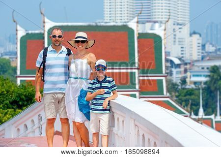 Young family standing on Stair at Golden mountain, an ancient pagoda at Wat Saket temple in Bangkok, Thailand