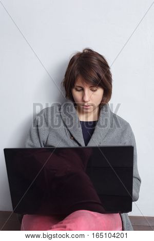 Tired Woman Sitting At The Laptop, Looking At Monitor Frustrated