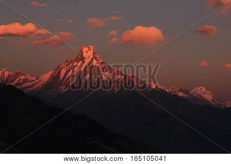 Evening scene in the Himalayas. Famous fish tail mountain Machapuchare Nepal.