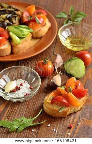 Various crostini with vegetables and herbs, vertical