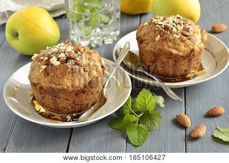 Wholegrain apple muffins with almonds, selective focus