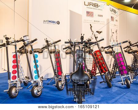 DETROIT MI/USA - JANUARY 12 2017: Several URB-E Sport foldable electric scooters at the North American International Auto Show (NAIAS).